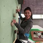 Julie Chen climbs the rock wall in the Big Brother 20 house