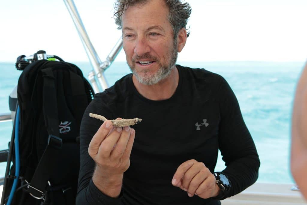 Darrell Miklos showing a recently discovered spoon on Cooper's Treasure Season 2