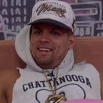 Faysal wearing the Power of Veto necklace in the Big Brother house
