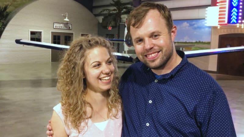 John David Duggar and Abbie Grace Burnett in an airplane hanger