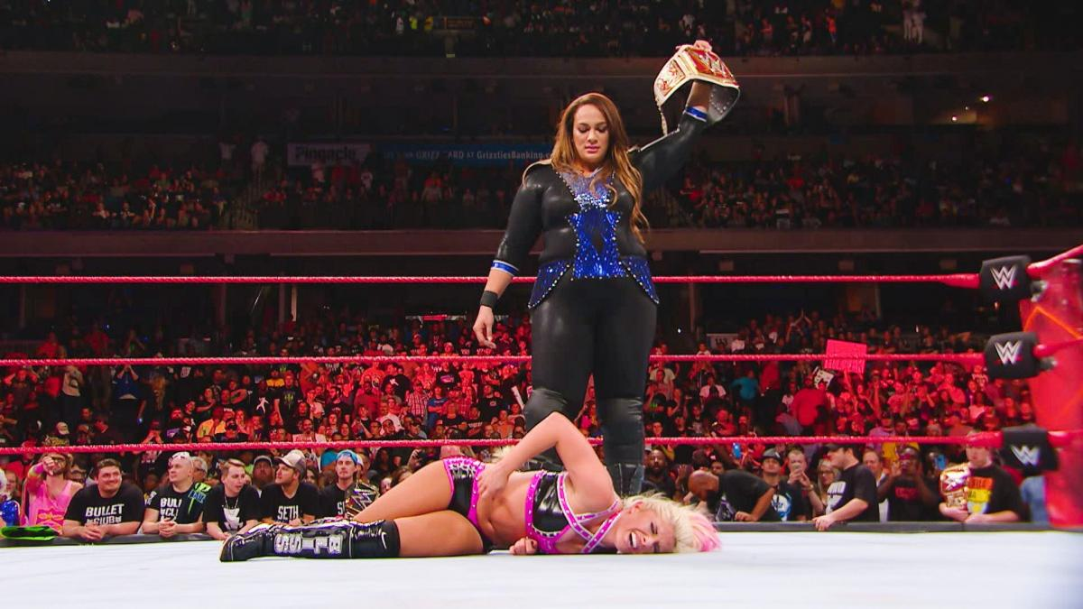 Nia Jax stands over Alexa Bliss