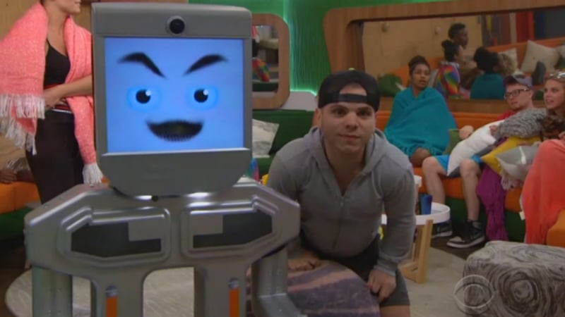 The BB20 computer and JC Monduix with the rest of the Big Brother 20 cast in the background