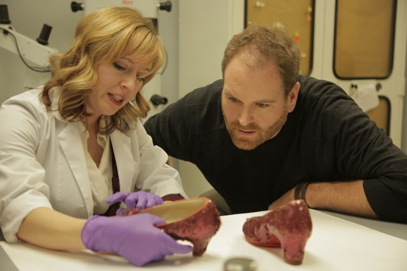 Josh looks at the ruby slippers from The Wizard of Oz with conservationist Dawn Wallace
