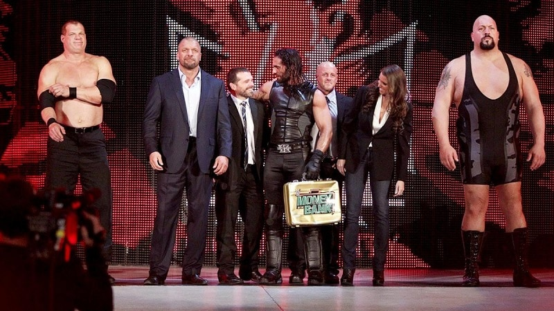 Seth Rollins and his muscle walk to the ring.