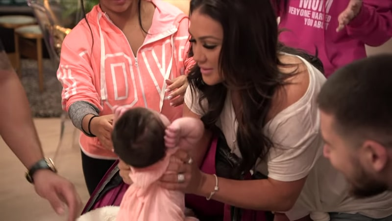 Jen Harley lifting baby Ariana out of her stroller on Jersey Shore Family Vacation