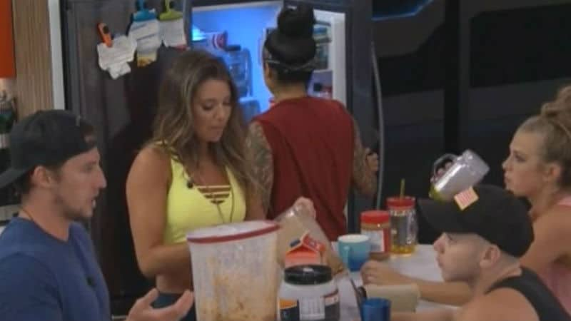 Big Brother houseguests in the kitchen