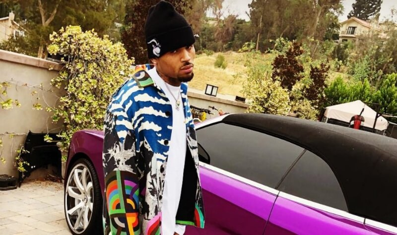 Chris Brown in front of one of his many sports cars