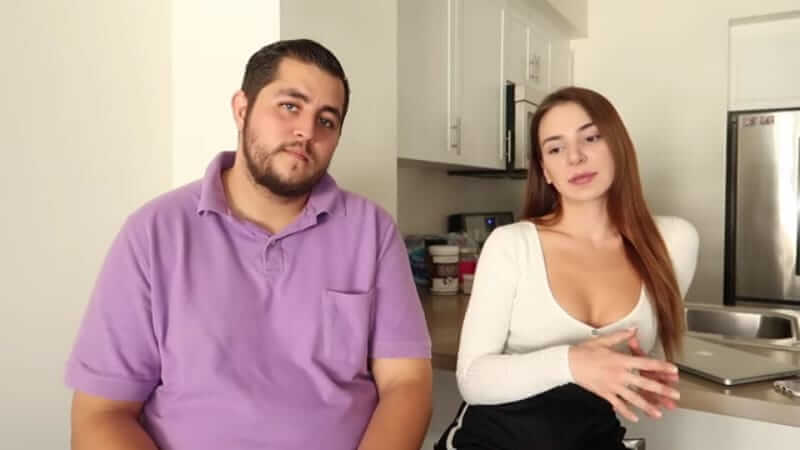 Jorge and Anfisa Nava sitting in their kitchen