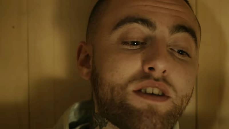 Mac Miller inside a wooden coffin in his music video for Self Care