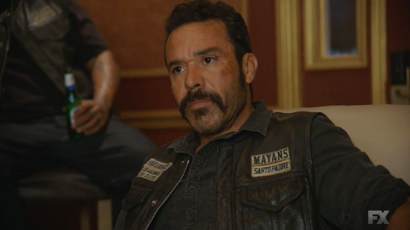 Still image:Mayans M.C. Búho/Muwan. President Bishop (Michael Irby) makes amends with Chen and the prison guards after losing a shipment to the Samoans. Pic credit: FX