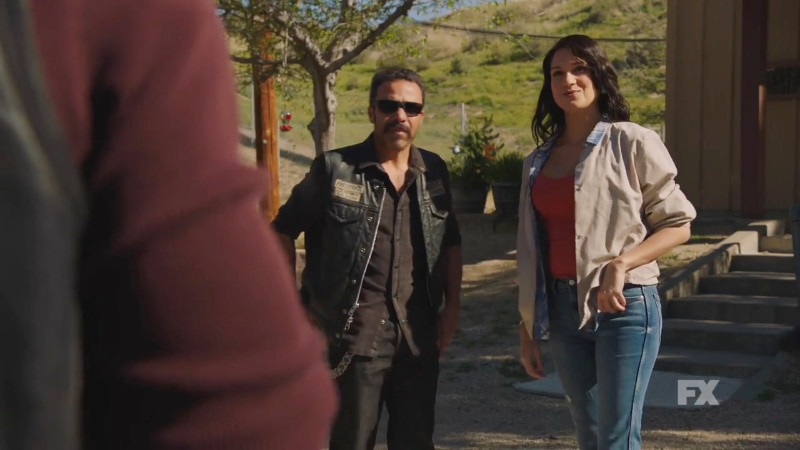 Still image from Mayans M.C. official trailer. President Bishop asks club friend, Gracie (Nomi Ruiz) about a new heroin source. Pic credit: FX