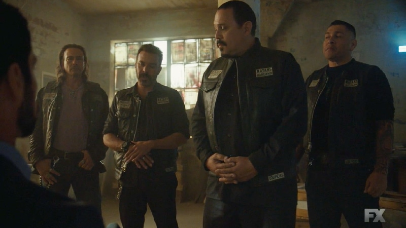 Still image:Mayans M.C. Búho/Muwan. The Santo Padre charter discuss business with their Chinese associates with Miguel (Danny Pino). Pic credit: FX