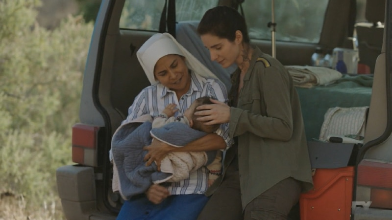 Still Image from Mayans M.C. Murciélago/Zotz. Miguel's spy Andres films Adelita and Sister Jane taking care of Cristobal. Pic credit: FX
