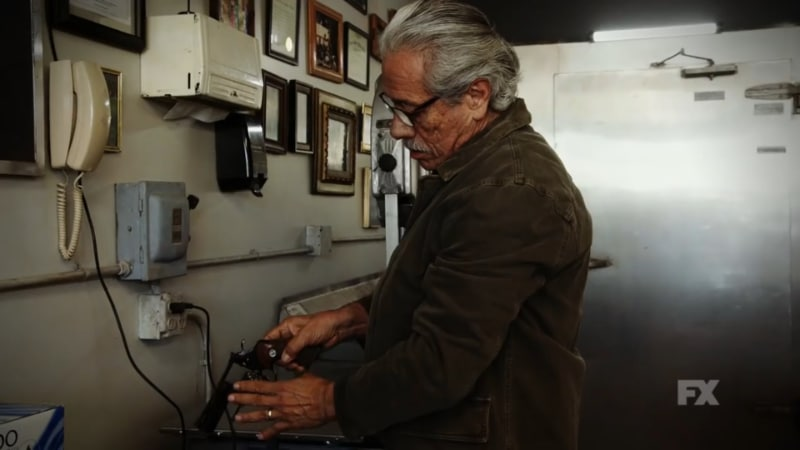 Still Image: Mayans M.C. Season 1 Ep. 5 Uch/Opossum Preview. Felipe Reyes loads a revolver in his butcher shop, preparing for a confrontation with the DEA. Pic Credit: FX