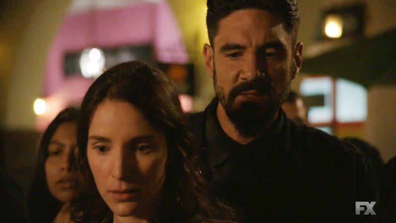 Still image from Mayans M.C. Escorpión/Dzec. Angel (Clayton Cardenas) and Adelita (Carla Baratta) discover the taco vendor and his son's fate. Pic credit: FX