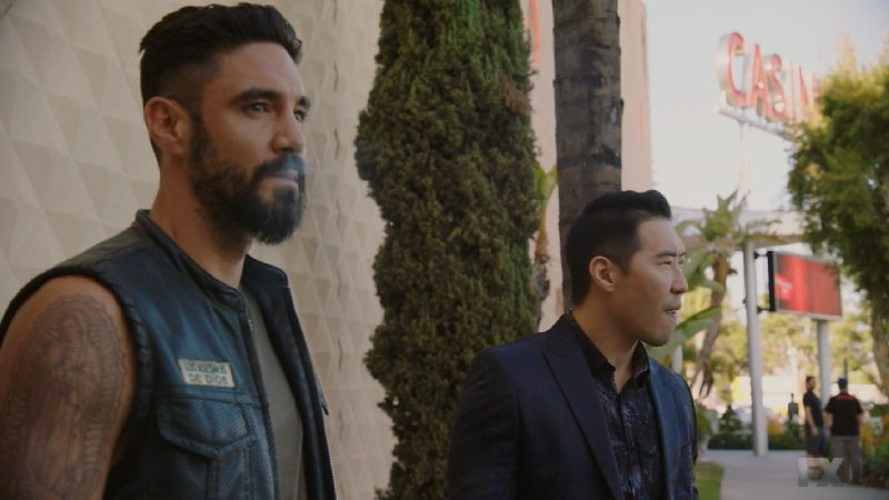 Still image:Mayans M.C. Búho/Muwan. Angel secretly meets with Jimmy Yen to arrange the sale of Adelita's heroin outside the casino. Pic credit: FX