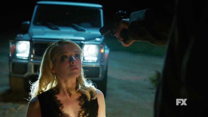Still image from Mayans M.C. official trailer. Emily is held at gunpoint by the Los Olvidados. Pic credit: FX