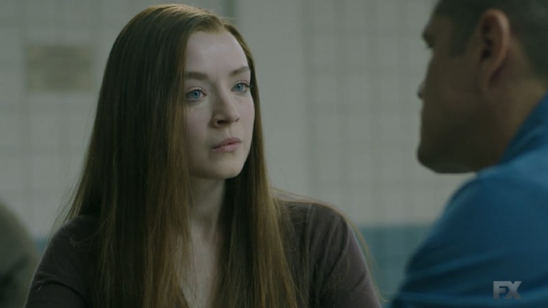 Still image from Perro/Oc. Emily meets EZ in Stockton prison during a flashback