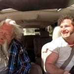 Gabe driving with Billy in the passenger seat on Alaskan Bush People