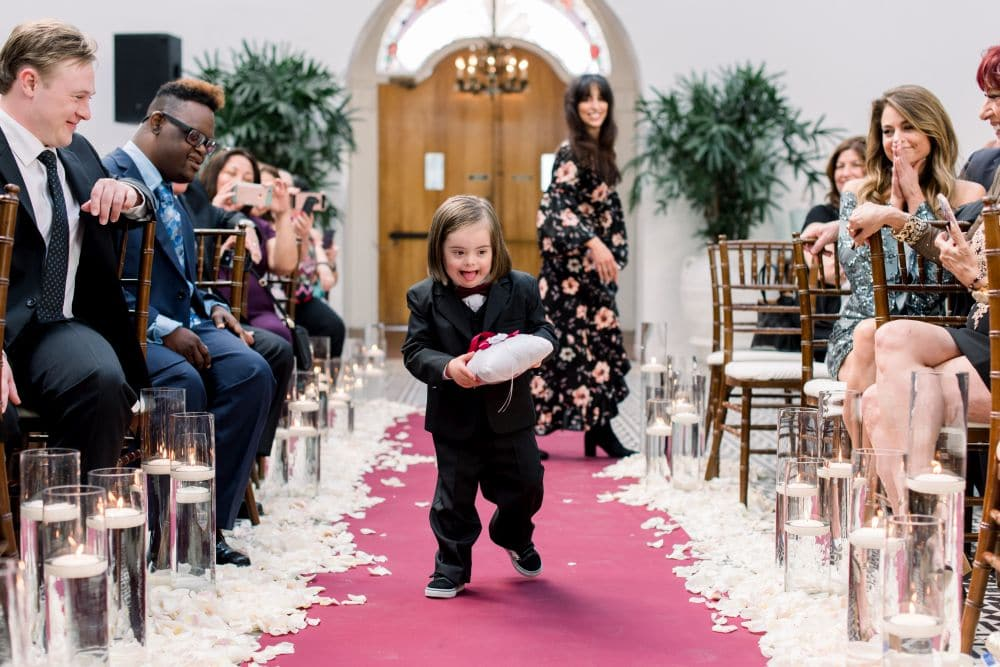 A wider shot showing how Rocco is delighting all who attend the wedding