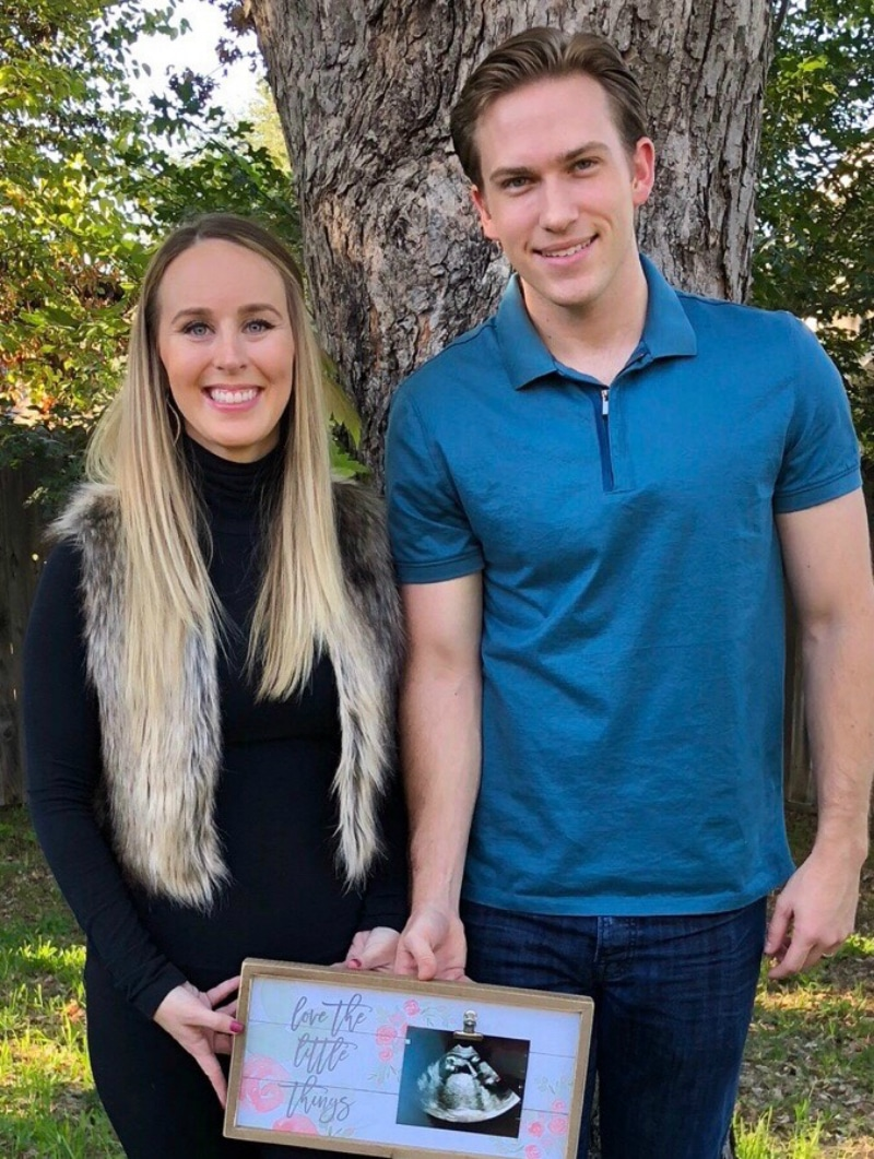 Danielle Bergman and Bobby Dodd pose with a picture from their ultrasound