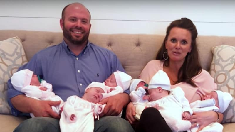 Eric and Courtney Waldrop holding the sextuplets
