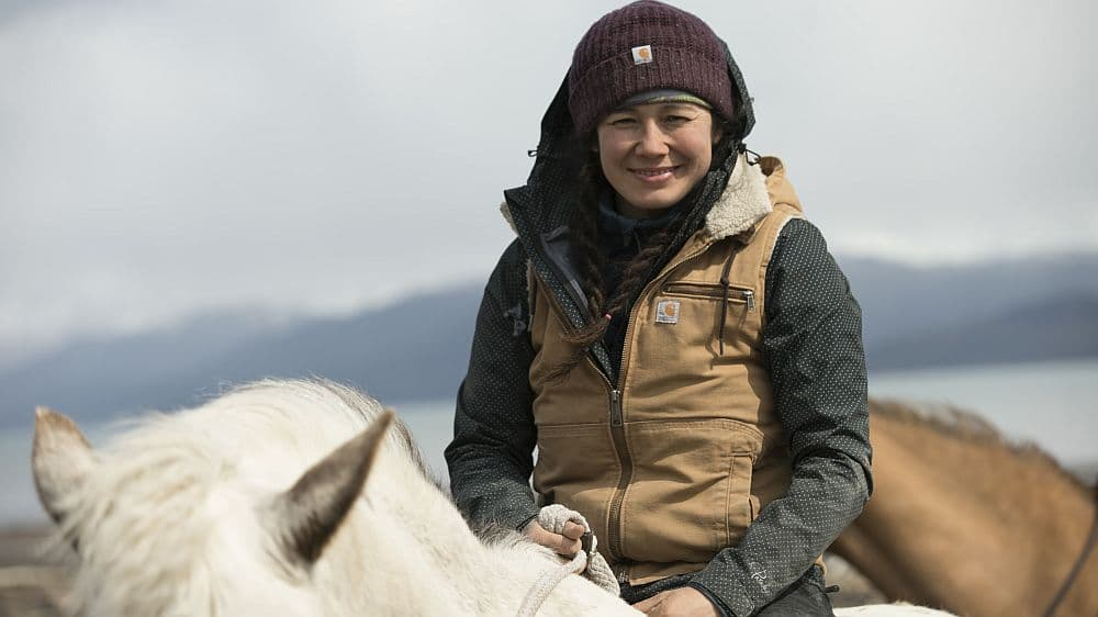 Tela on a horse driving cattle. Pic credit: Discovery