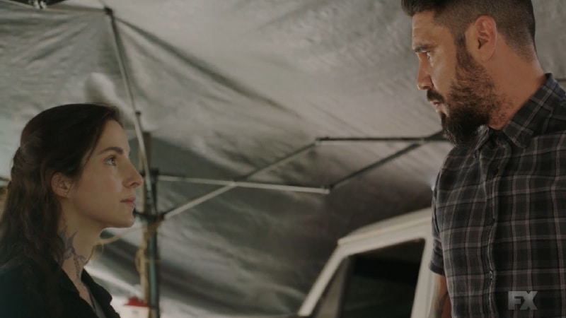 Still image from Mayans M.C. Gato/Mis. Angel explains to Adelita that he can't protect his club if he's in the dark. She reveals her true name is Luisa Espina and her plan with Galindo. Pic credit: FX