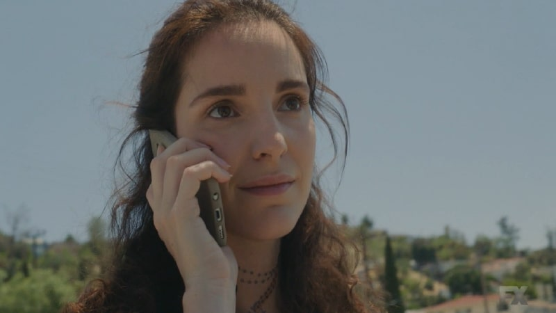 Still image from Mayans M.C. Gato/Mis. Adelita calls Miguel with the demands for the return of Cristobal. Pic credit: FX