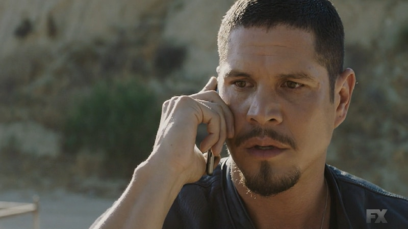 Still Image from Mayans M.C. Cucaracha/K'uruch. During the gun deal with the SOA, Kevin warns EZ not to get apprehended in front of the club. Pic Credit: FX.