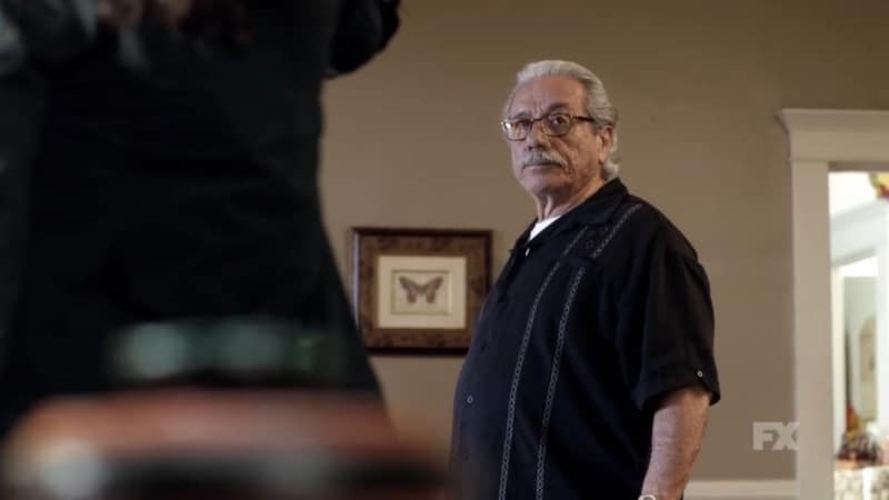 Still image from Mayans M.C. Cucaracha/K'uruch preview. Felipe Reyes tells Adelita there is something she needs to see as she threatens him with a gun. Pic Credit: FX