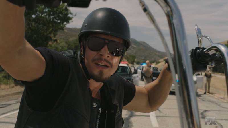 Still Image from Mayans M.C. Cucaracha/K'uruch. EZ Reyes leads police away from the M.C. before surrendering. Pic Credit: FX.