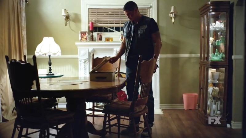 Still image from Mayans M.C. Cucaracha/K'uruch preview. EZ returns home from the clubhouse to see the lockbox of Felipe's past. Pic Credit: FX