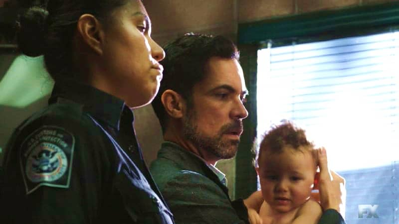 Still image from Mayans M.C. Gato/Mis. Miguel retrieves his son, but is stopped by the security guard Adelita paid off in the market. Pic credit: FX