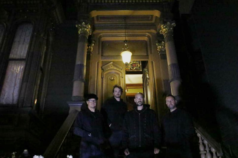Zak Bagans and the Ghost Adventures crew on the front steps of the Westerfeld House