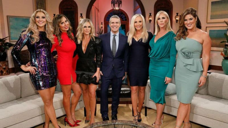 The ladies of The Real Housewives of Orange County with Andy Cohen in the middle