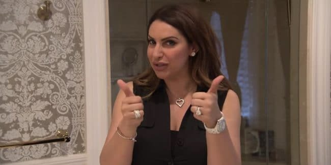 Jennifer Aydin gives two thumbs up during a tour of her New Jersey mansion