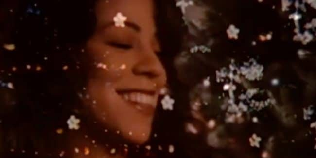 Mariah Carey smiling in her music video for All I Want For Christmas