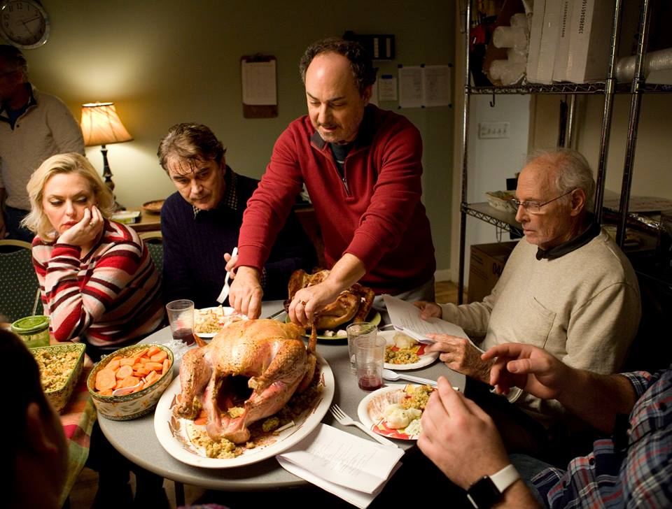 This poor turkey has been through a lot- Dad (Pollak) tries to carve it. Pic credit: Gravitas ventures
