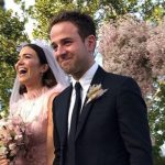Mandy Moore in her pink wedding dress with husband