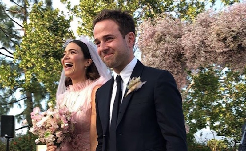 Mandy Moore in her pink wedding dress with husband Taylor Goldsmith