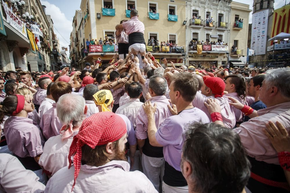 Phil Keoghan becomes part of the Human Tower as a Castell in Villafranca del Penedes, Spain - Pic credit: National Geographic/Xavi Torrent