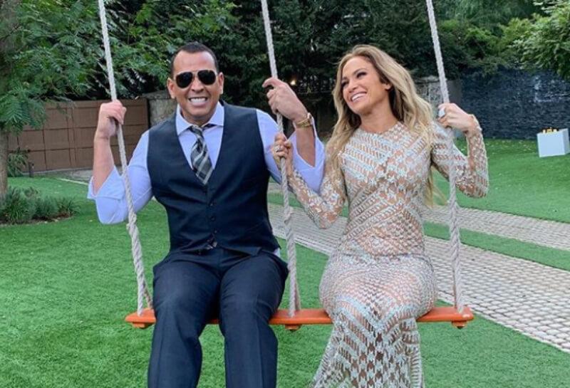 Alex Rodriguez and Jennifer Lopez on a swing