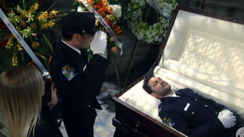 Dante saluting Nathan during his funeral