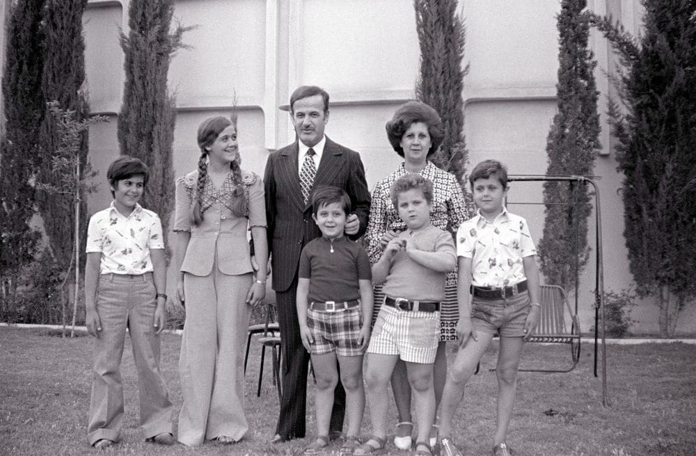 Syrian President, Hafez El Assad, and his family pose for a photograph. June 4, 1974 in Damascus, Syria. L-R are the late Bassel, Bouchra, Hafez, Maher, Majd, Anisa (Hafez's wife), and Bashar. Pic credit: Nat Geo via Getty Images/Alexandra De Borchgrave