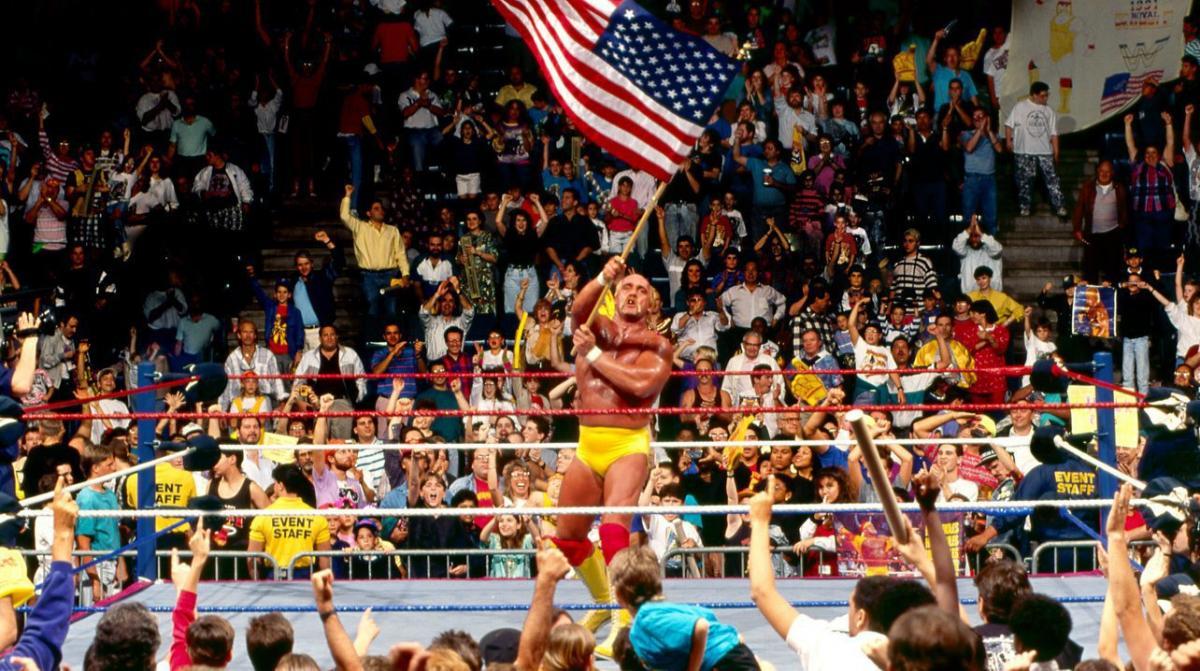 Hulk Hogan waves the American flag in the WWE ring