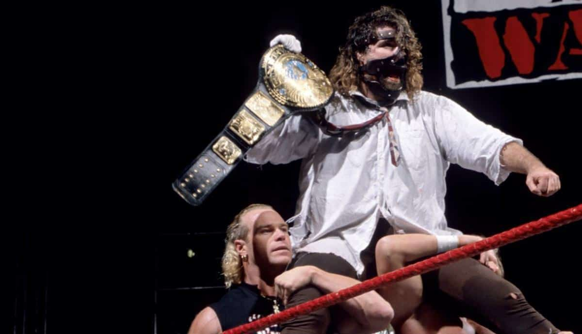 Mick Foley holding a championship belt in the WWE