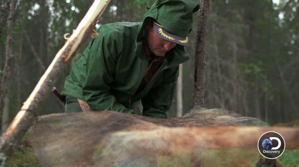 Atz Lee patiently explains how to build a smoker in the wild. Pic credit: Discovery