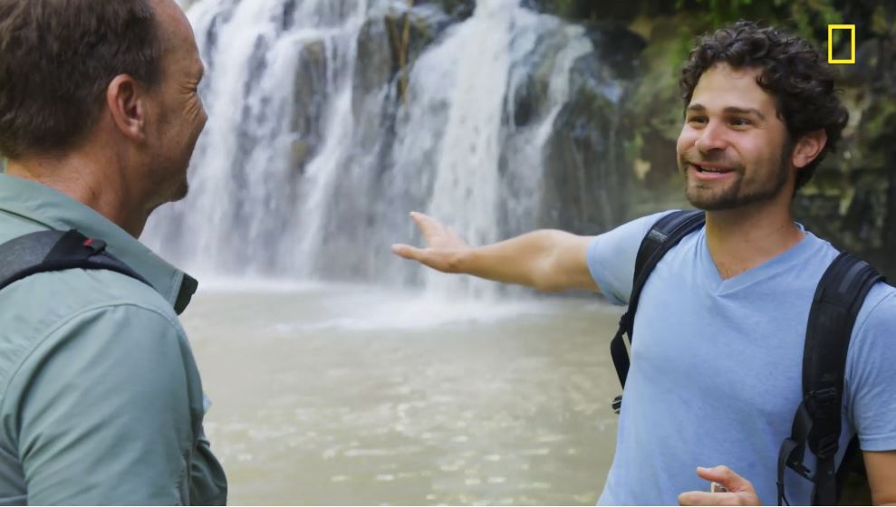 Andrés Ruzo tells Phil Keoghan about the boiling river, deadly if you fall in. Pic credit: Nat Geo Channel