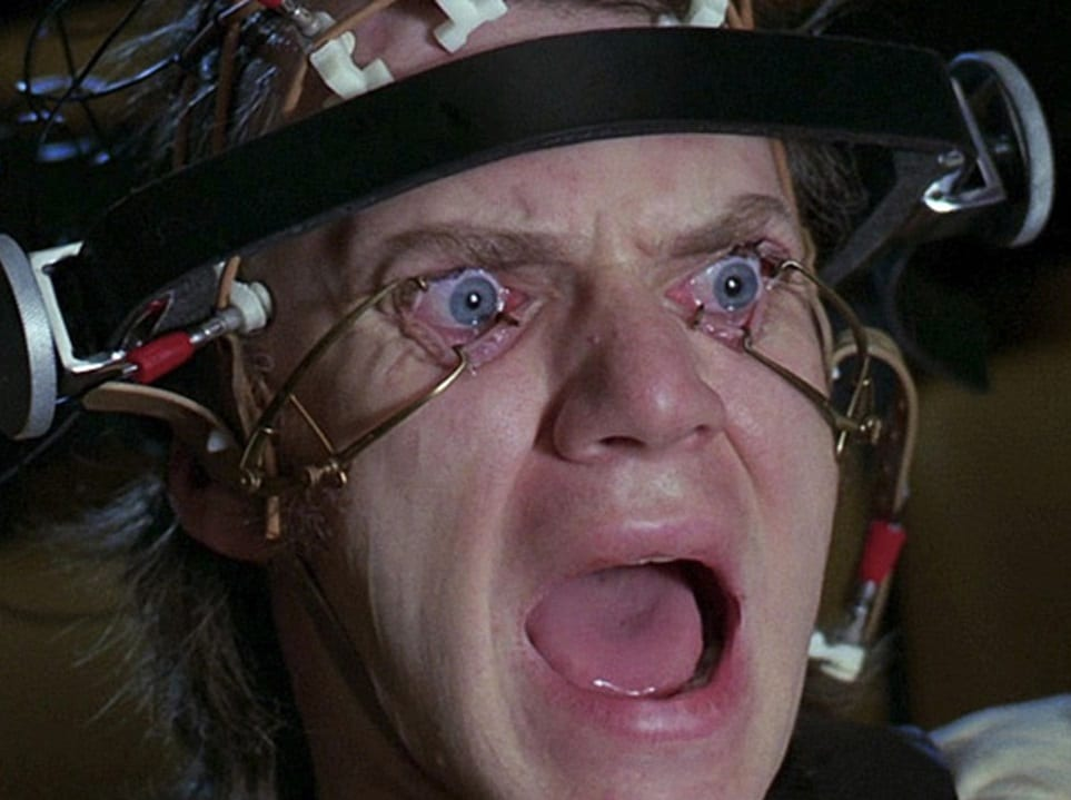 Alex (Malcolm McDowell), is being reprogrammed and forced to watch unspeakable things on TV in Stanley Kubrick's A Clockwork Orange. Pic credit: Warner Bros.